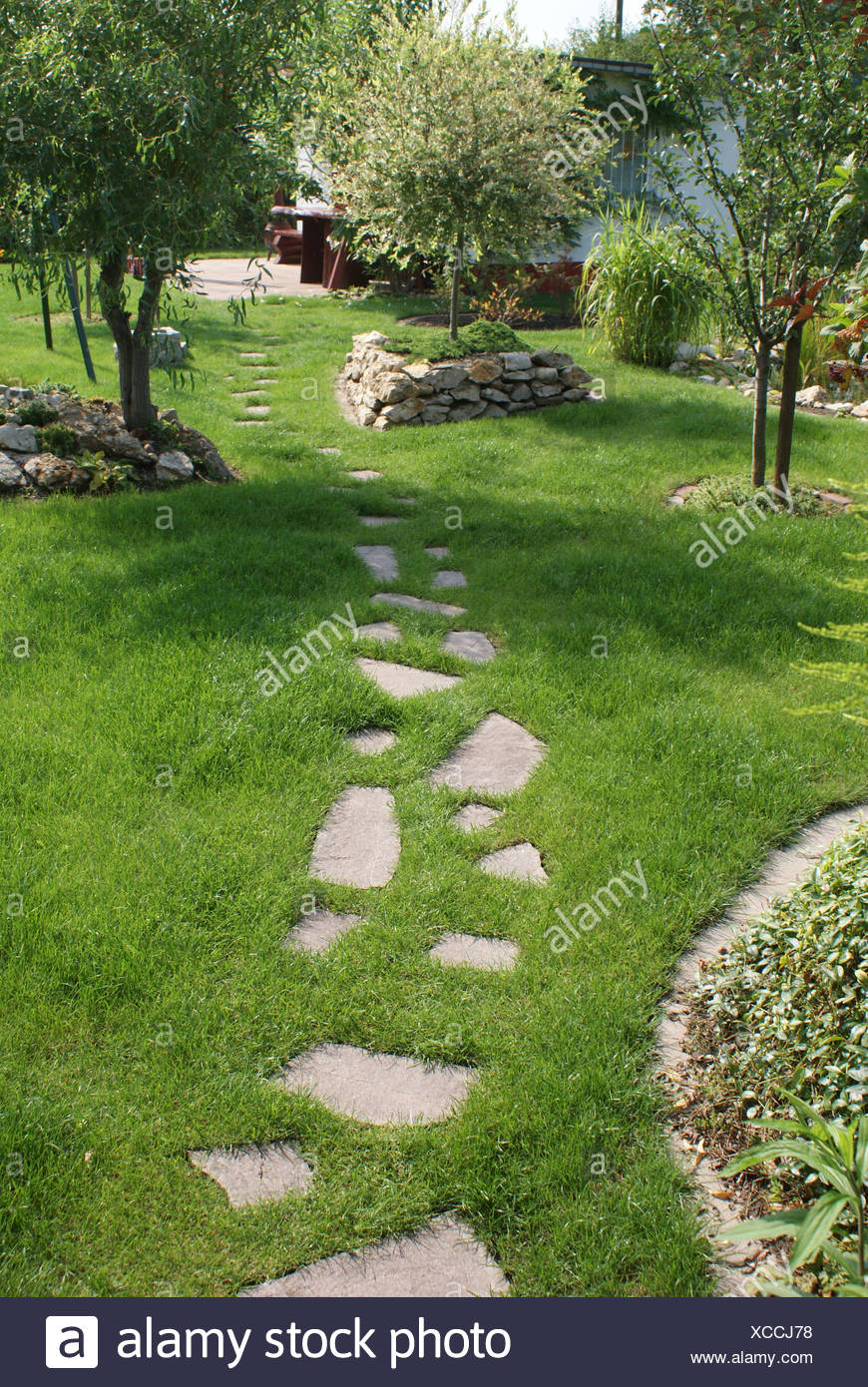 Stone-way in lawn Stock Photo