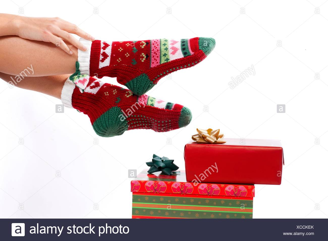 Female legs in christmas stockings isolated on white Gifts on the ...