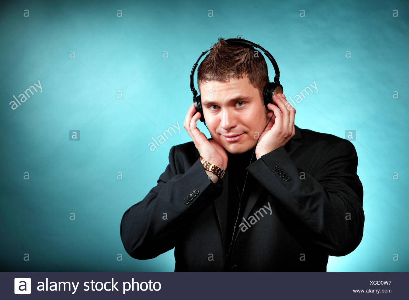 Young Happy Man Student With Headphones Listening To Music