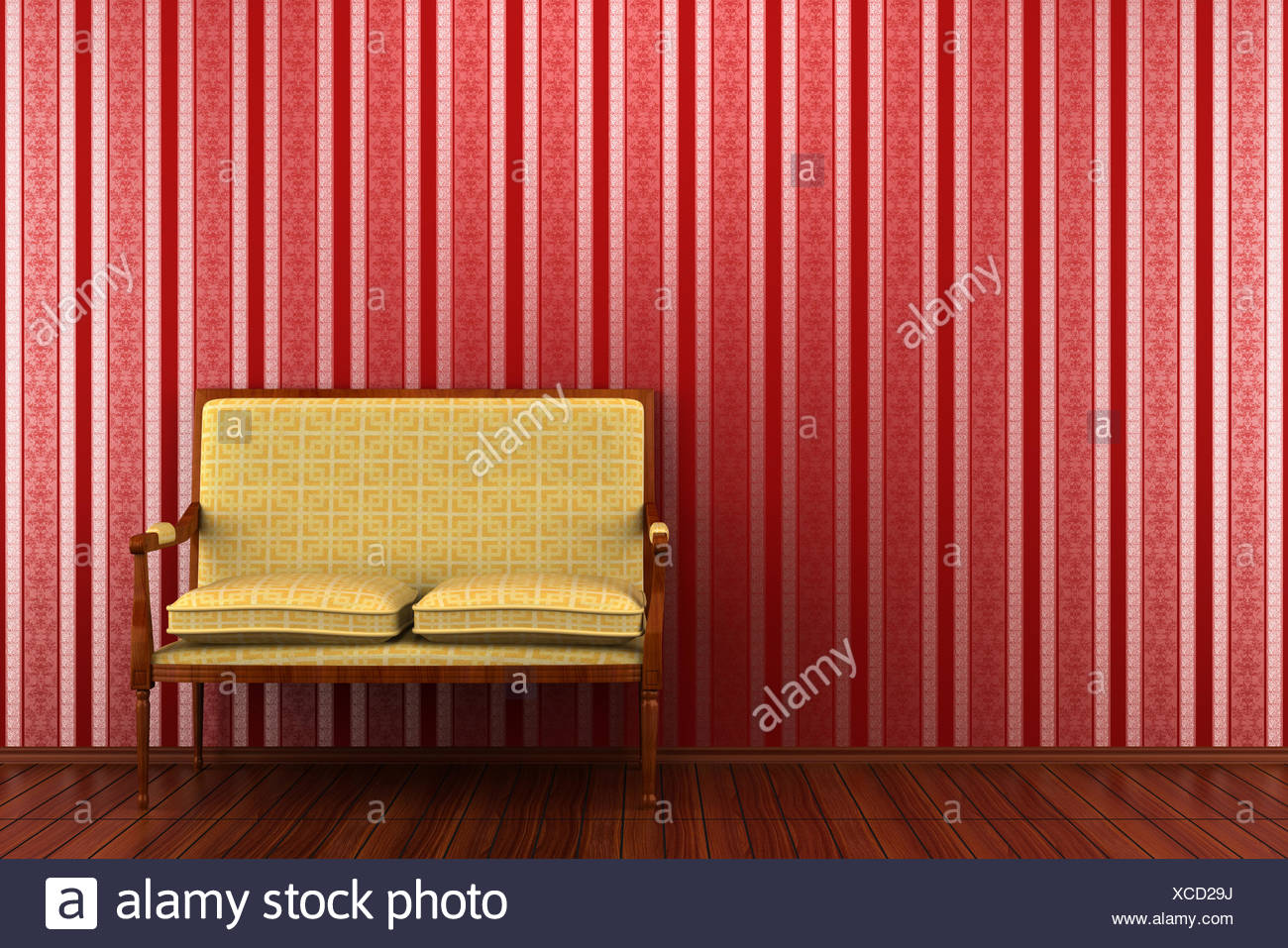 yellow classic sofa in front of red striped wall Stock Photo ...