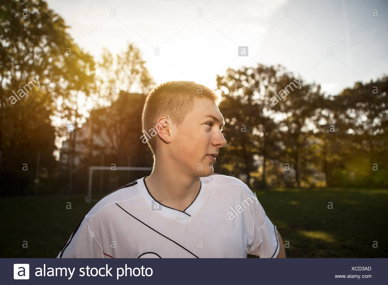 Teenager on soccer pitch looking around - Stock Image