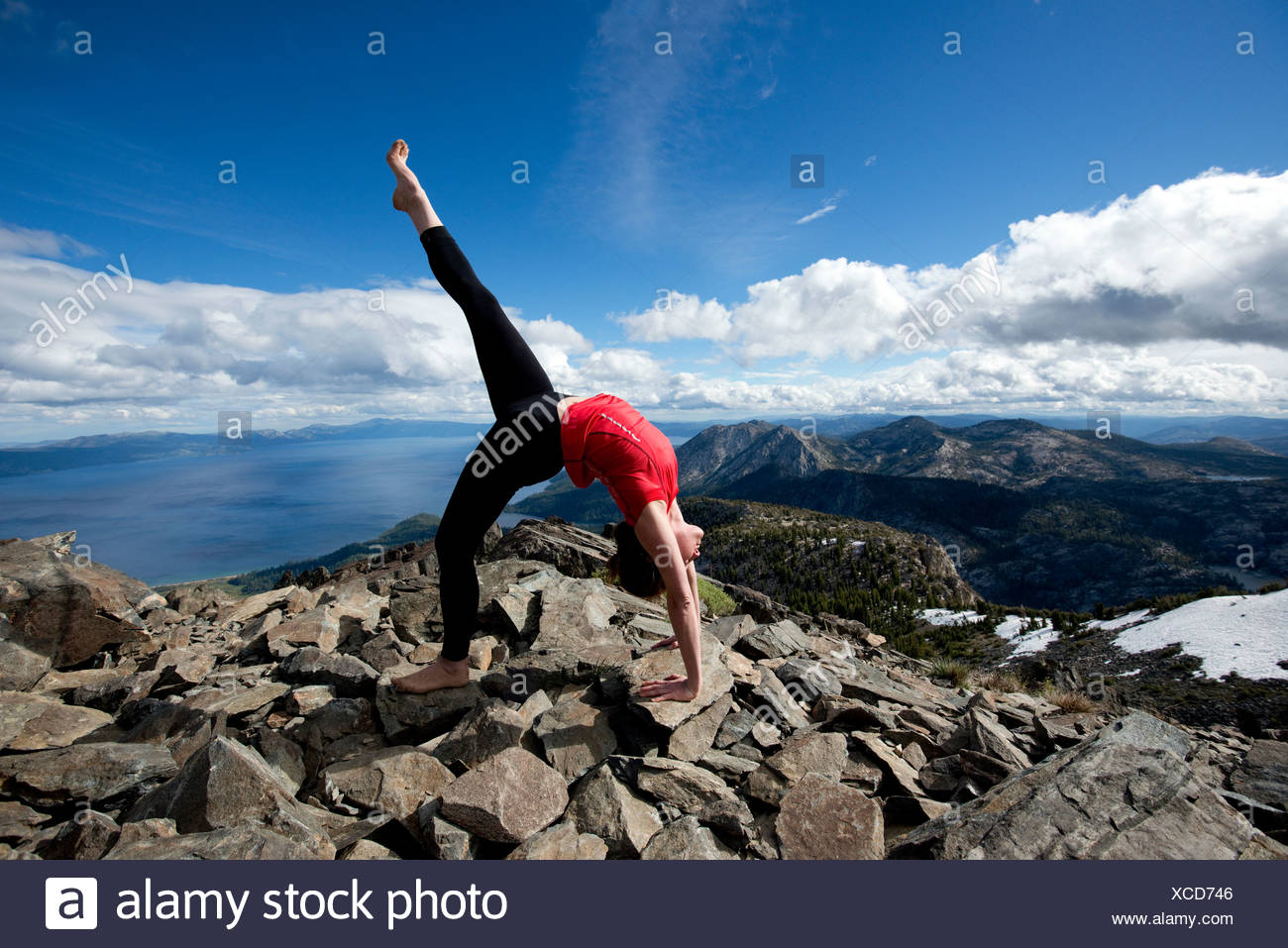 A Woman Performs Yoga On Top Of Mount Tallac Overlooking Lake Tahoe On A Beautiful Afternoon Near South Lake Tahoe Ca Stock Photo Alamy