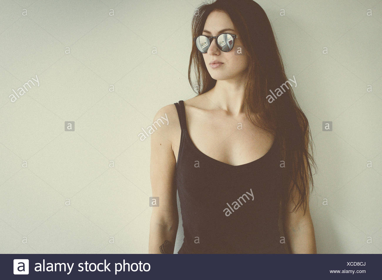 Young woman with sunglasses, portrait - Stock Image