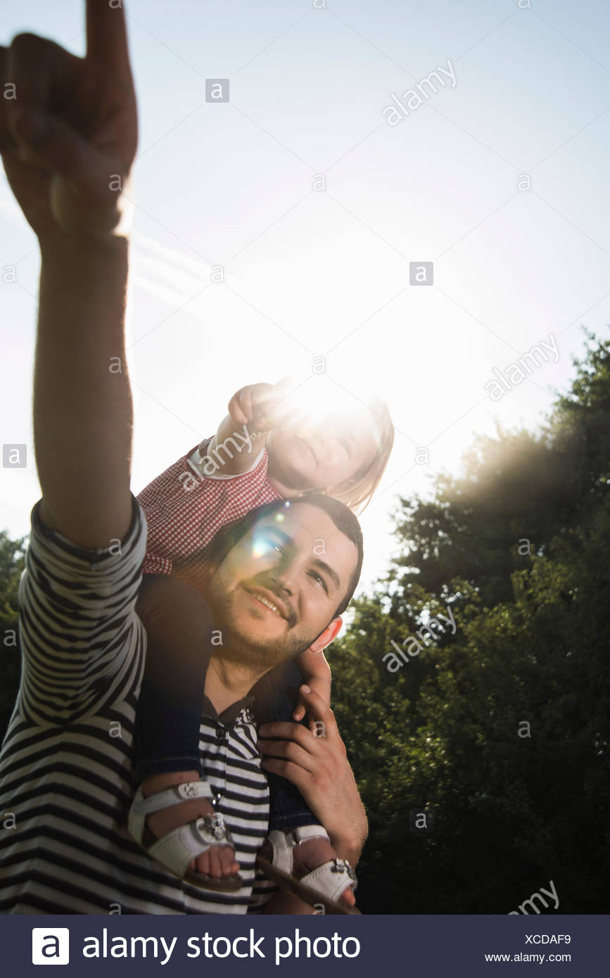 Father showing his little daughter something - Stock Image