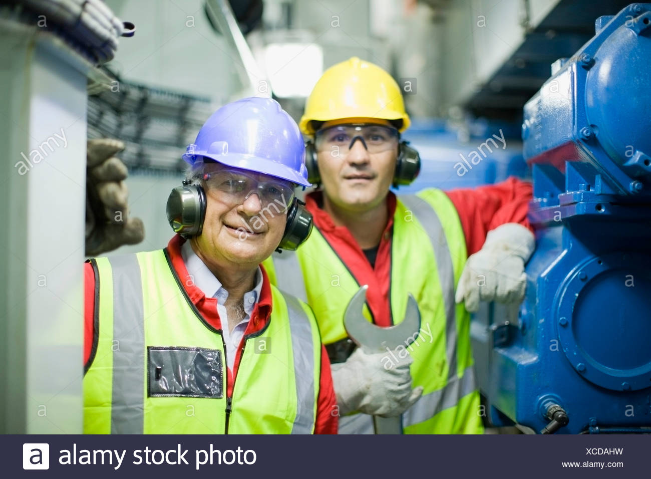 2 workers in engine room Stock Photo
