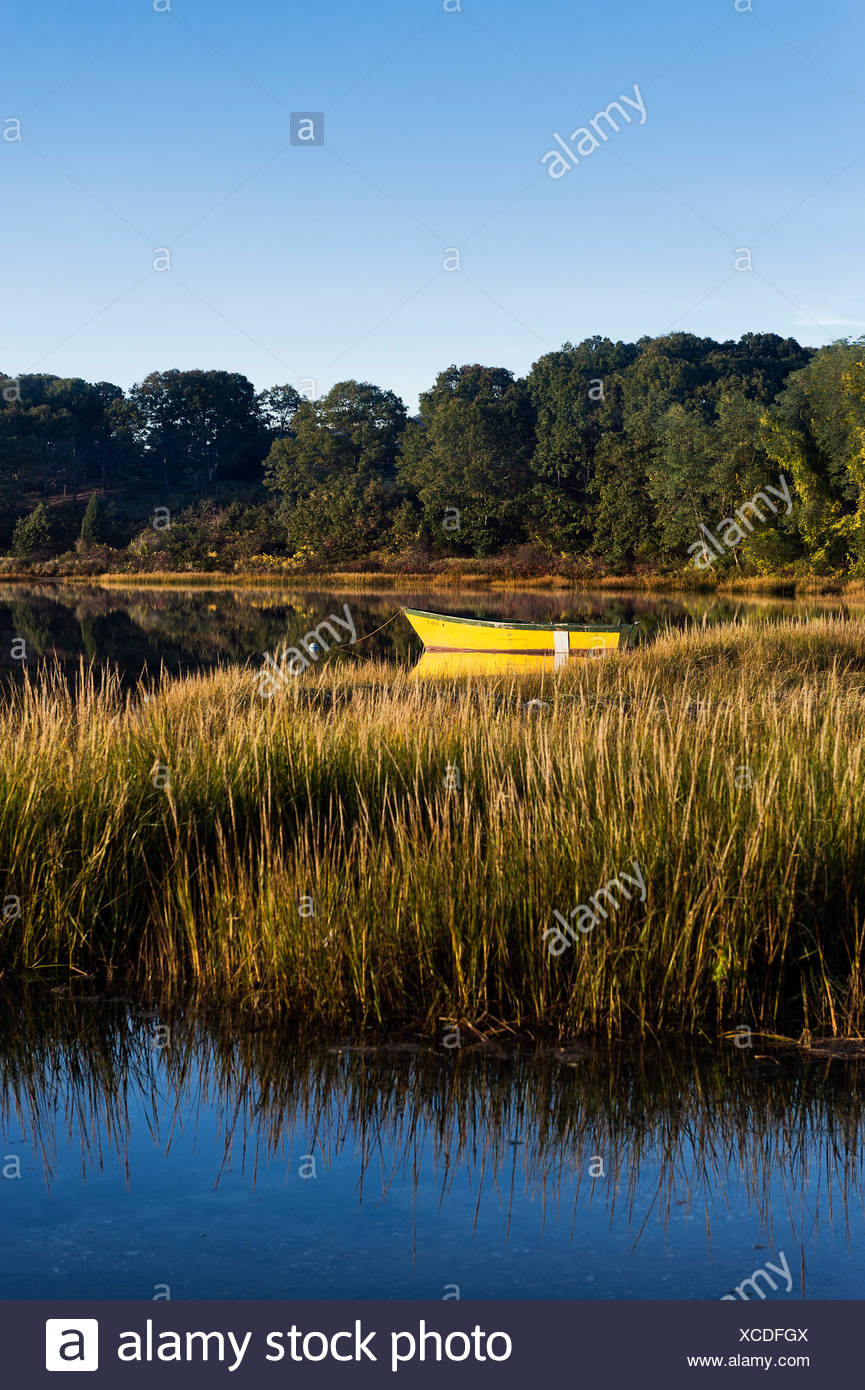 Rowboat anchored in a coastal inlet. - Stock Image