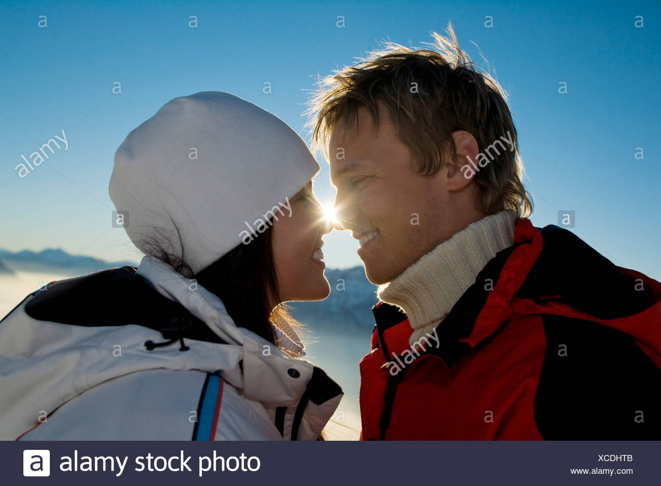 young couple in the mountains tenderly looking at each other Stock Photo