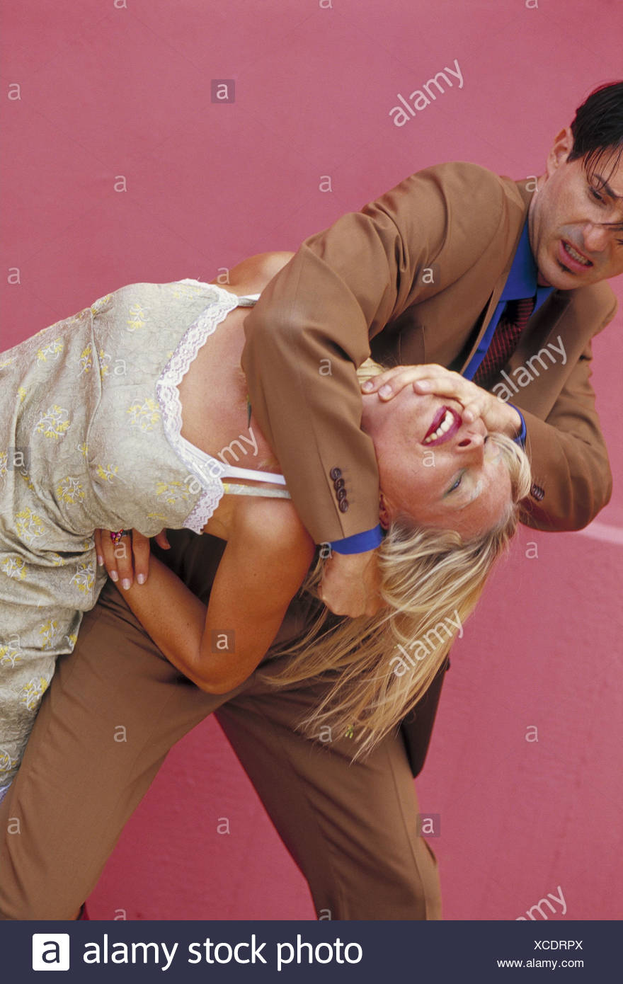 Couple, young, fight, use force adults, intentionally, power, brutality, brutally, cruelly, cruelty, violence, personal injury, maltreatment, intemperance, aggression, aggressiveness, hostage, kidnapping, taking hostages - Stock Image