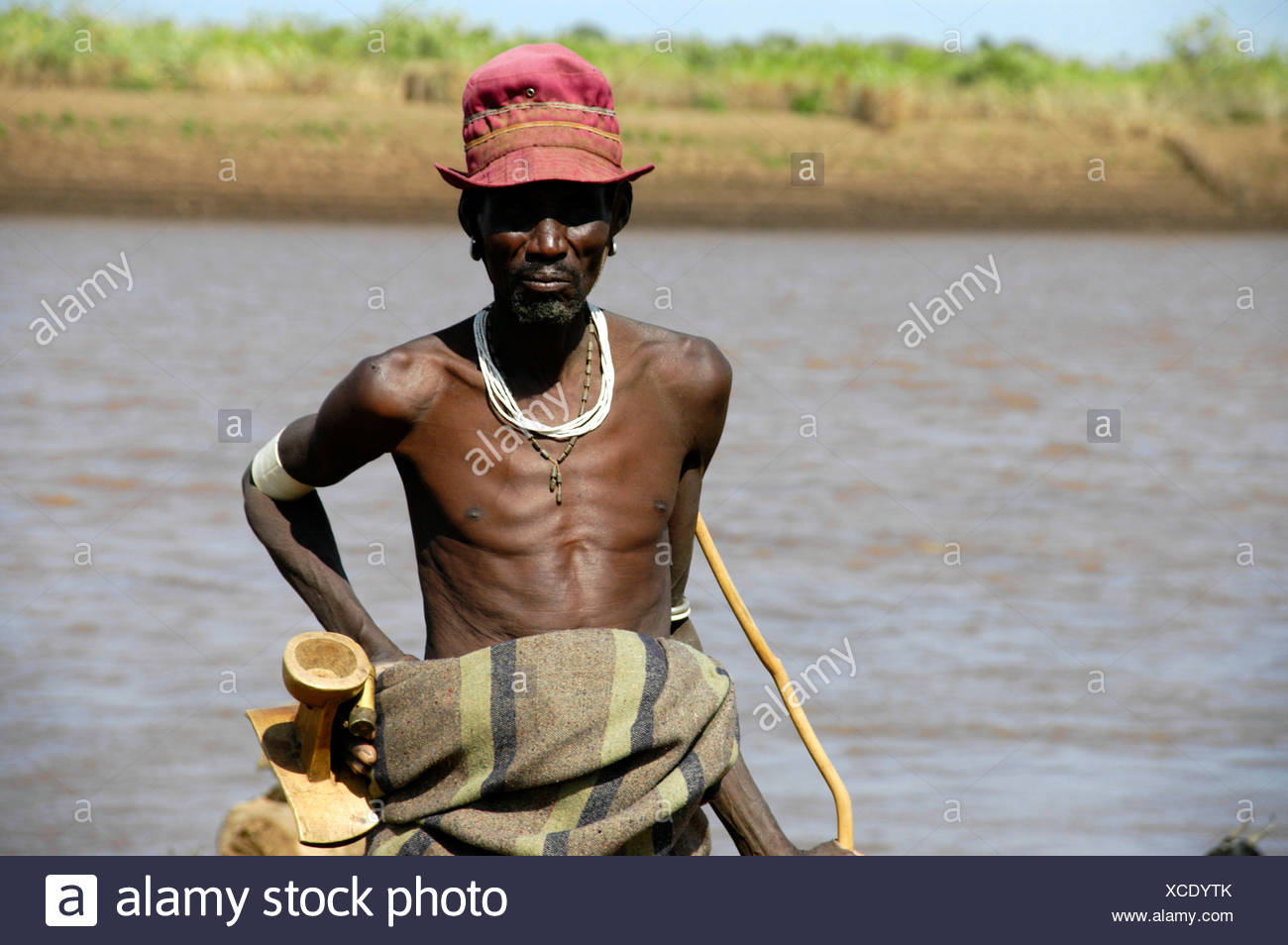 Skinny man with hat at Omo River, Dashenesh people, Ethiopia, Africa - Stock Image