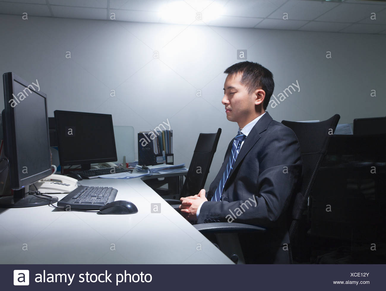 White-collar worker sitting in office - Stock Image