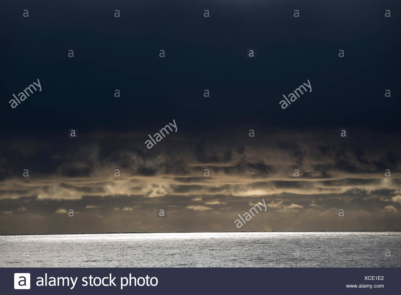 Sunset on the open water heading to the Falkland Islands. - Stock Image