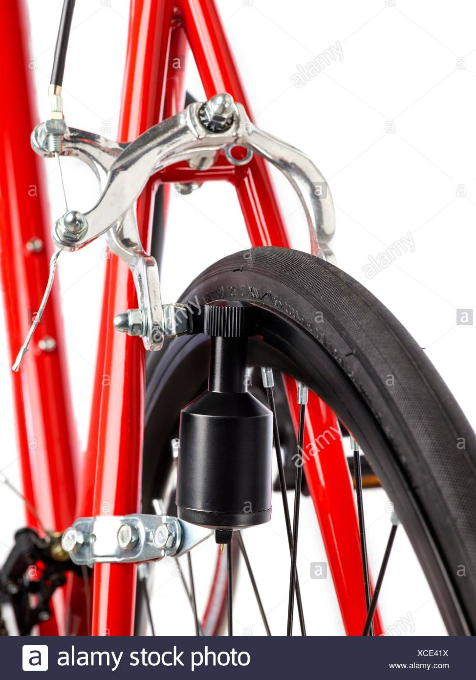 Bicycle dynamo fixed to the back wheel, close up. - Stock Image