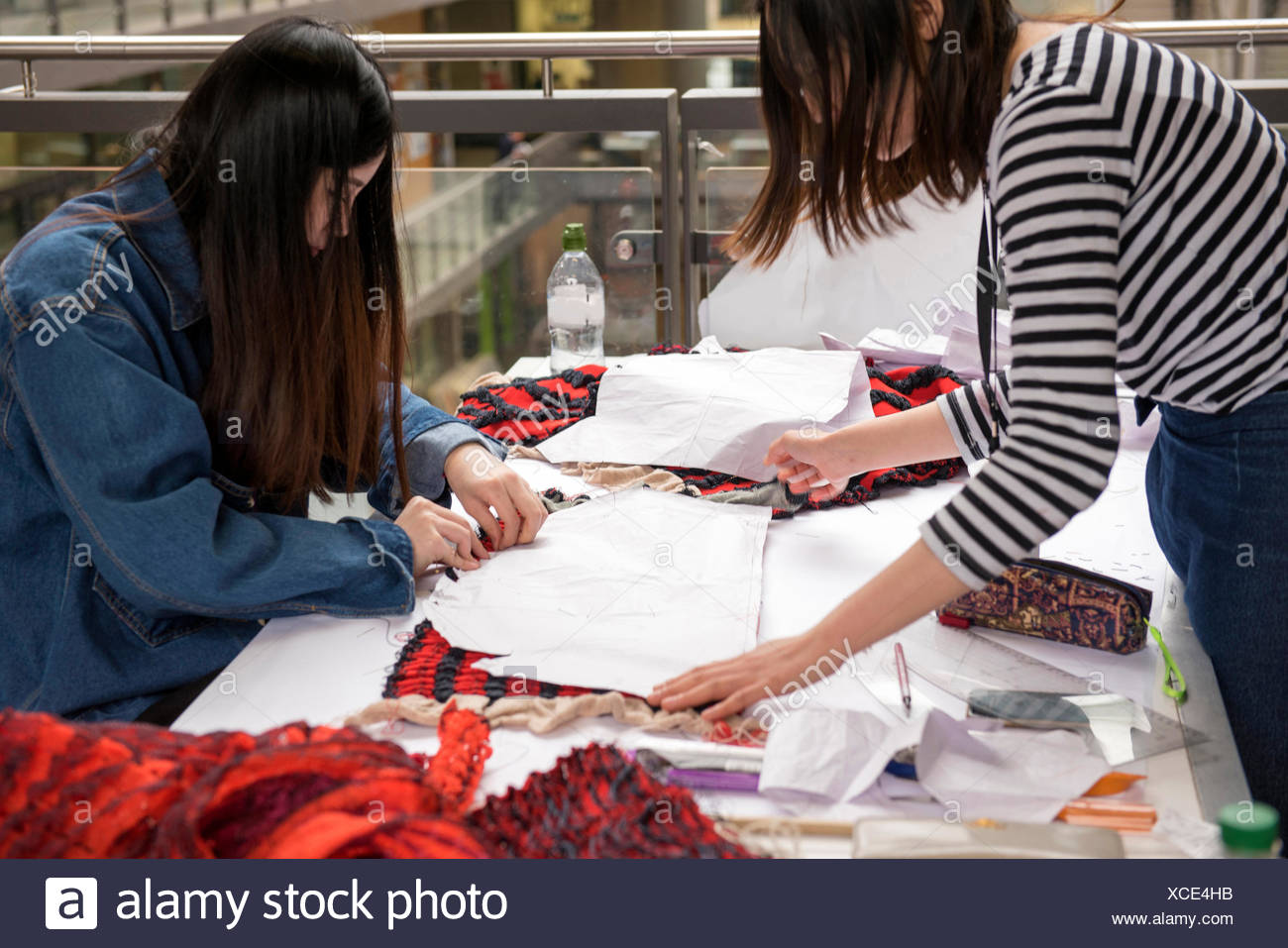 Seamstresses creating garment - Stock Image