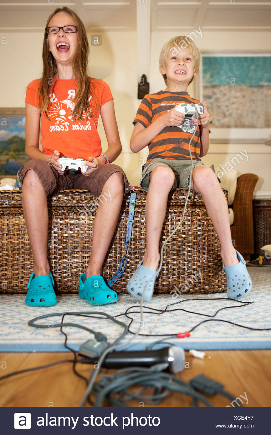 Boy and Girl with Game controls - Stock Image