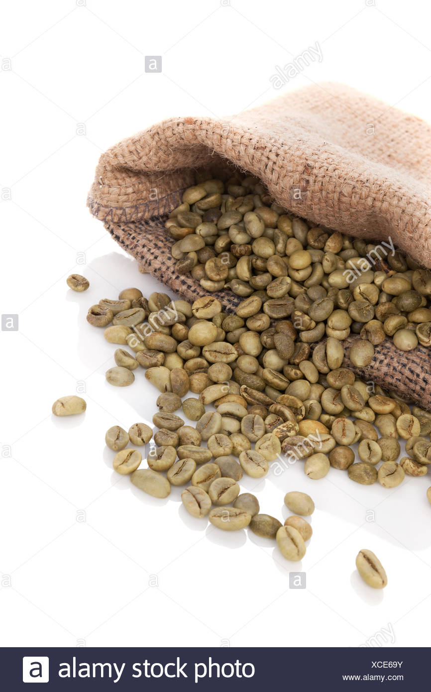 Green coffee beans in burlap bag isolated on white background. Dietary supplements, appetite suppressant. Weight loss concept. - Stock Image