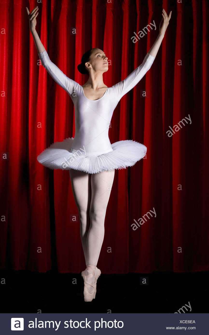 A ballet dancer posing on stage - Stock Image