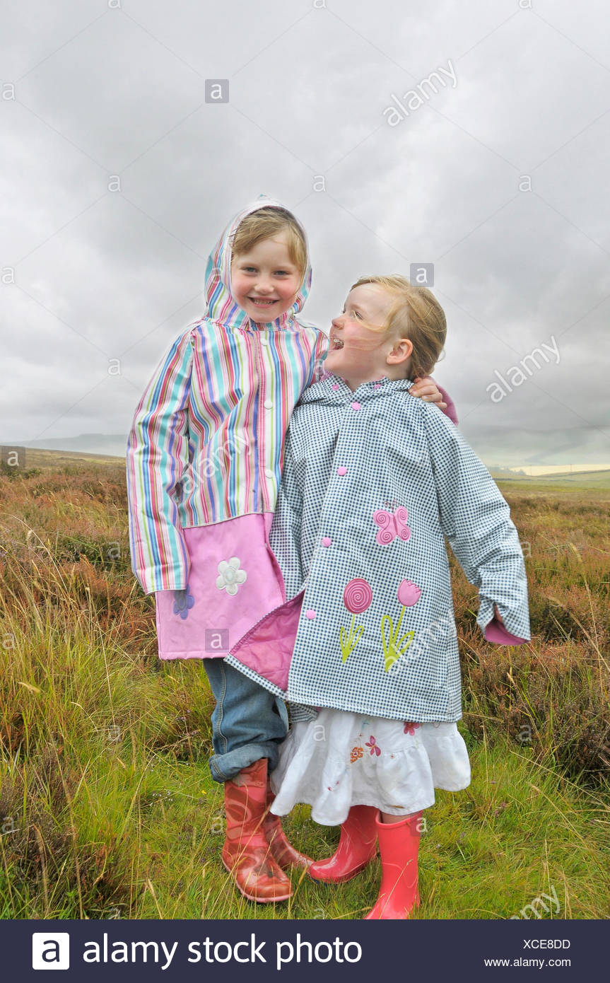 2 little girls laughing in the moorlands - Stock Image