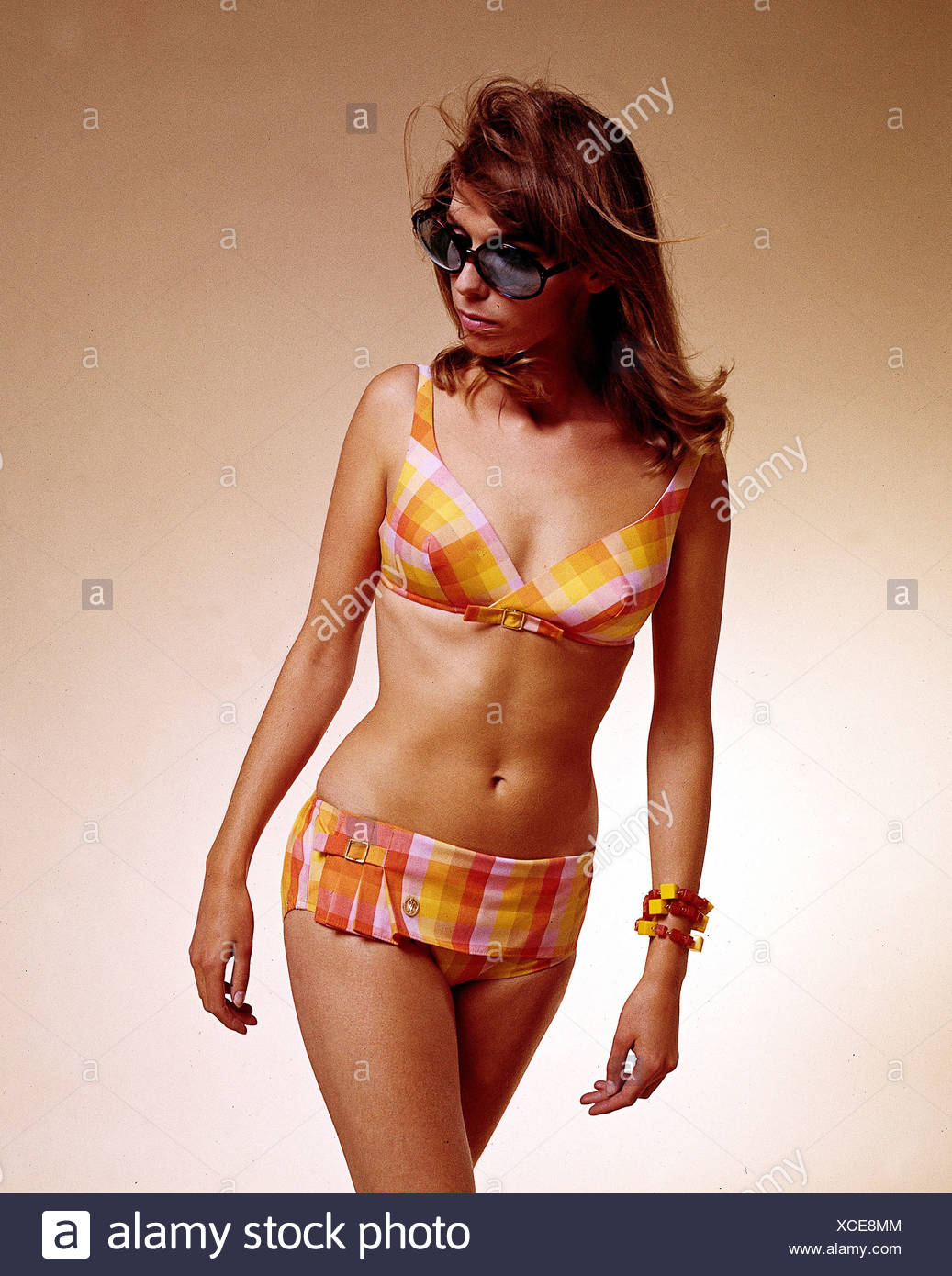 fashion, 1960s, model, wearing bikini, chequered, half length, studio, clothing, women, bathing suit, two-piece, two piece, 60s, ladieswear, woman, bikini, shades, sun glasses, sunglasses, , Additional-Rights-Clearances-NA - Stock Image