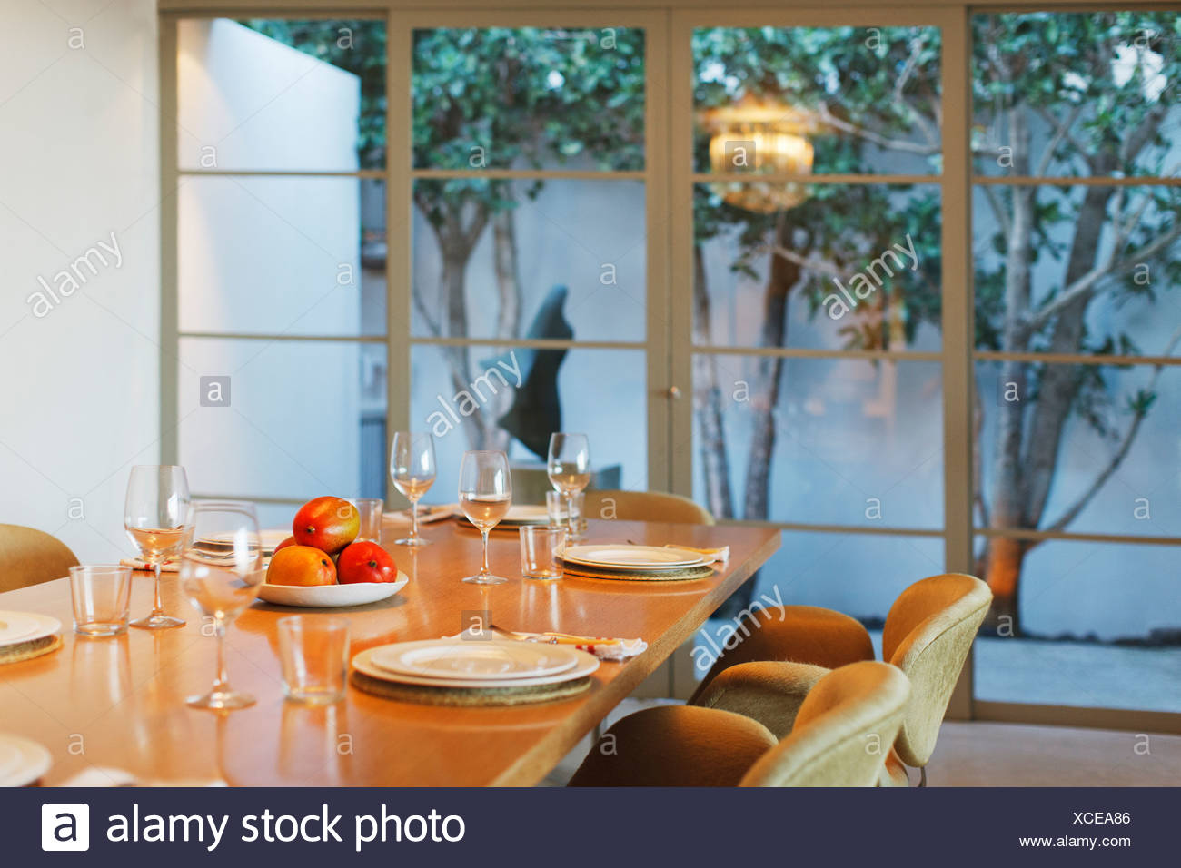 Place settings on dining table - Stock Image