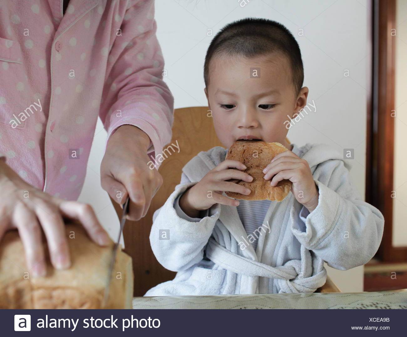 Boy (2-3) eating breakfast - Stock Image
