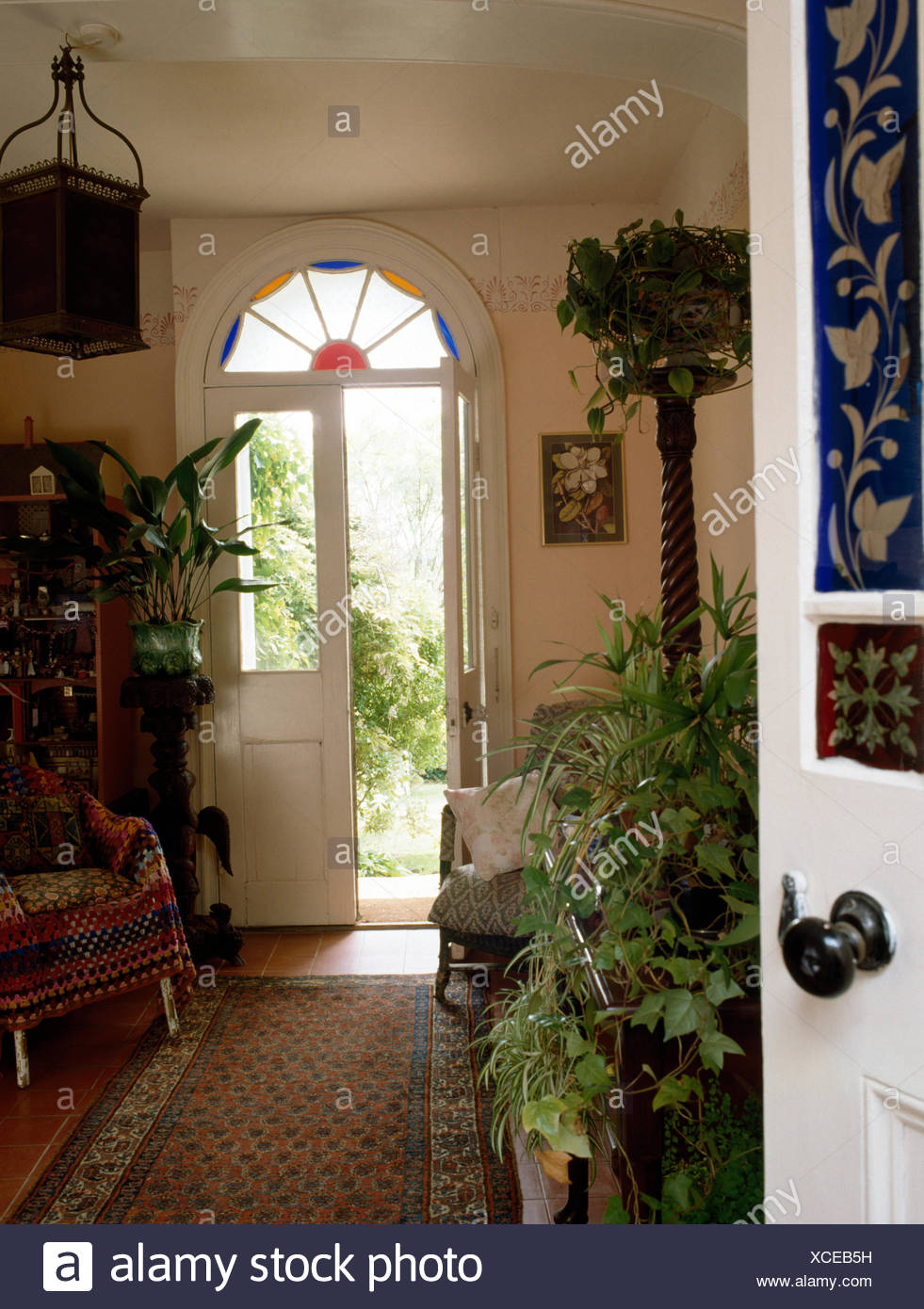 house front door open. Lush Green Houseplants In Early Nineties Victorian Hall With Open Front Door - Stock Image House