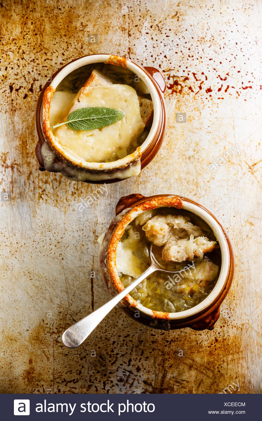 Authentic French Onion soup with dried bread and cheddar cheese in bowl - Stock Image