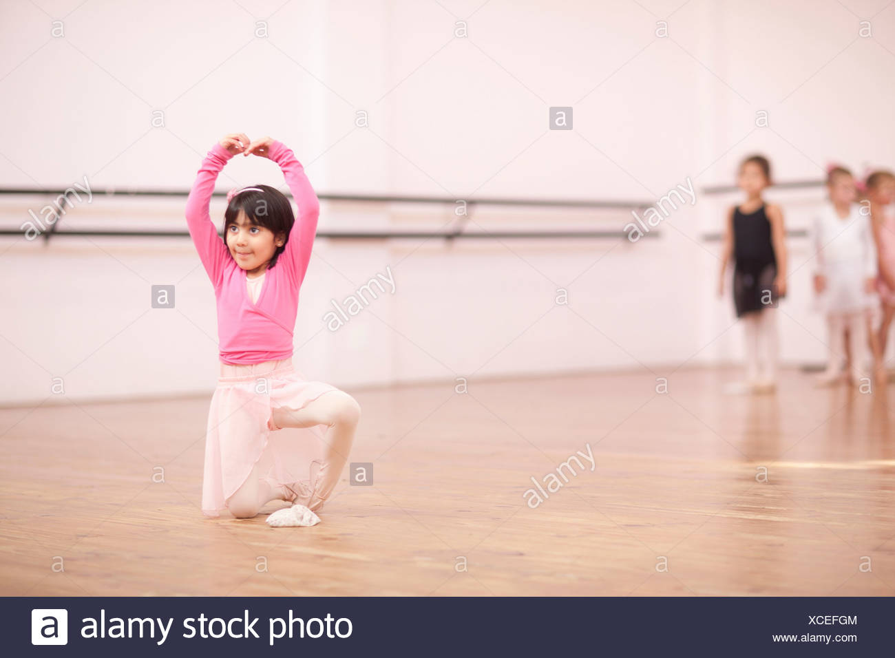 Young ballerina posing in studio Stock Photo