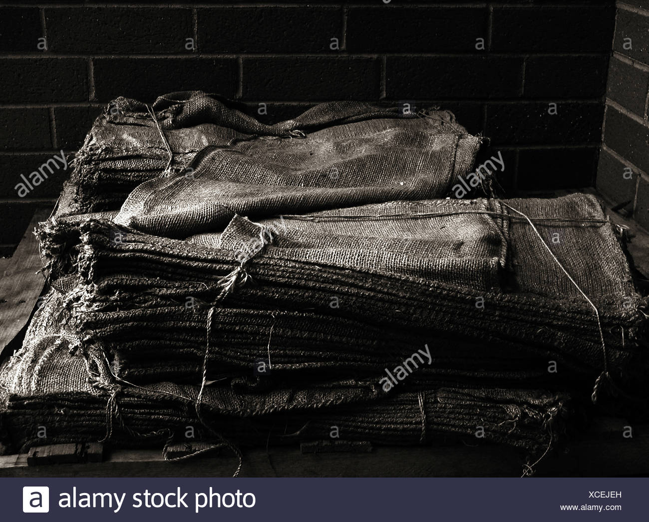 Empty sandbags in sepia - Stock Image