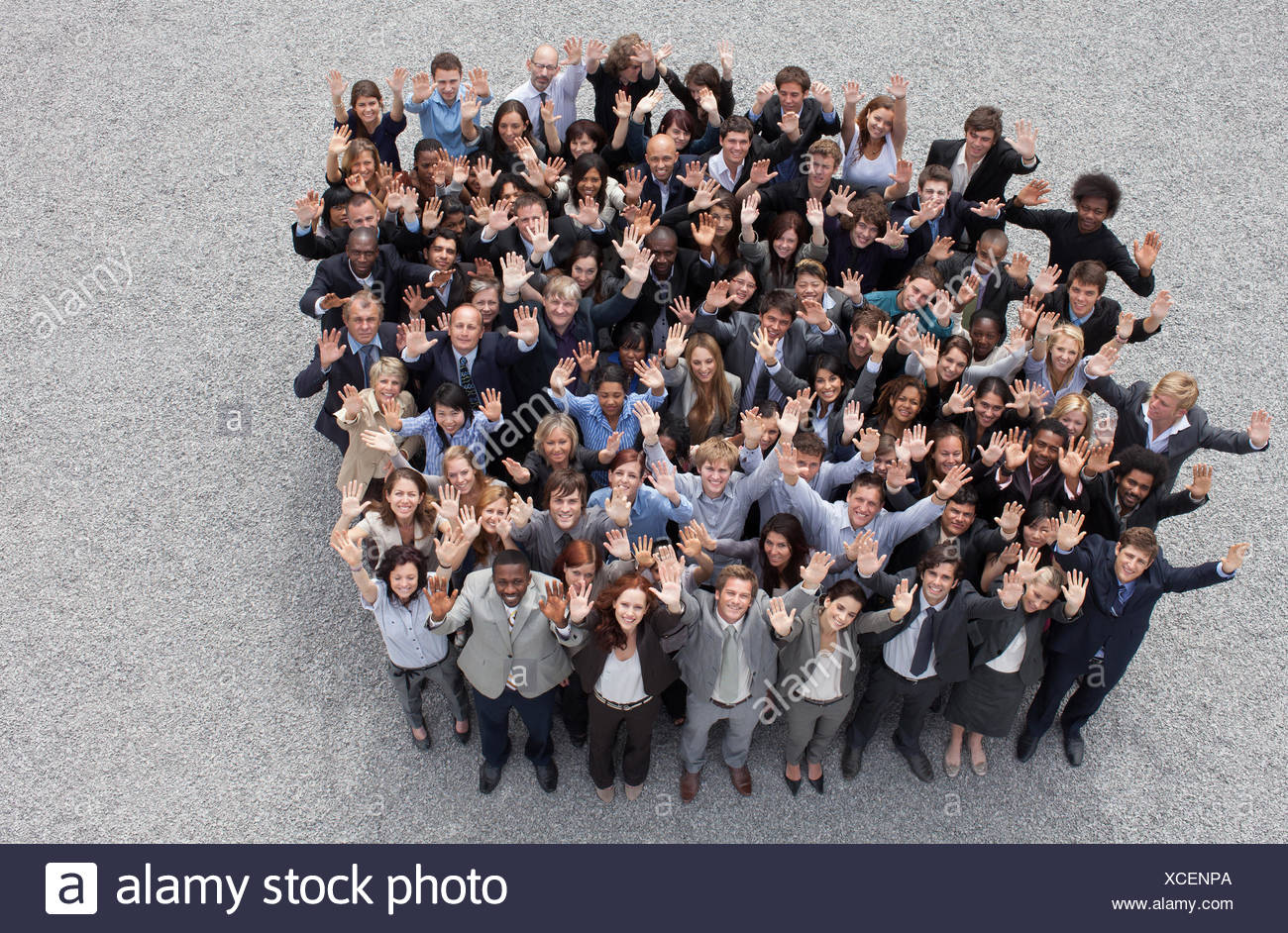 Portrait of waving business people - Stock Image