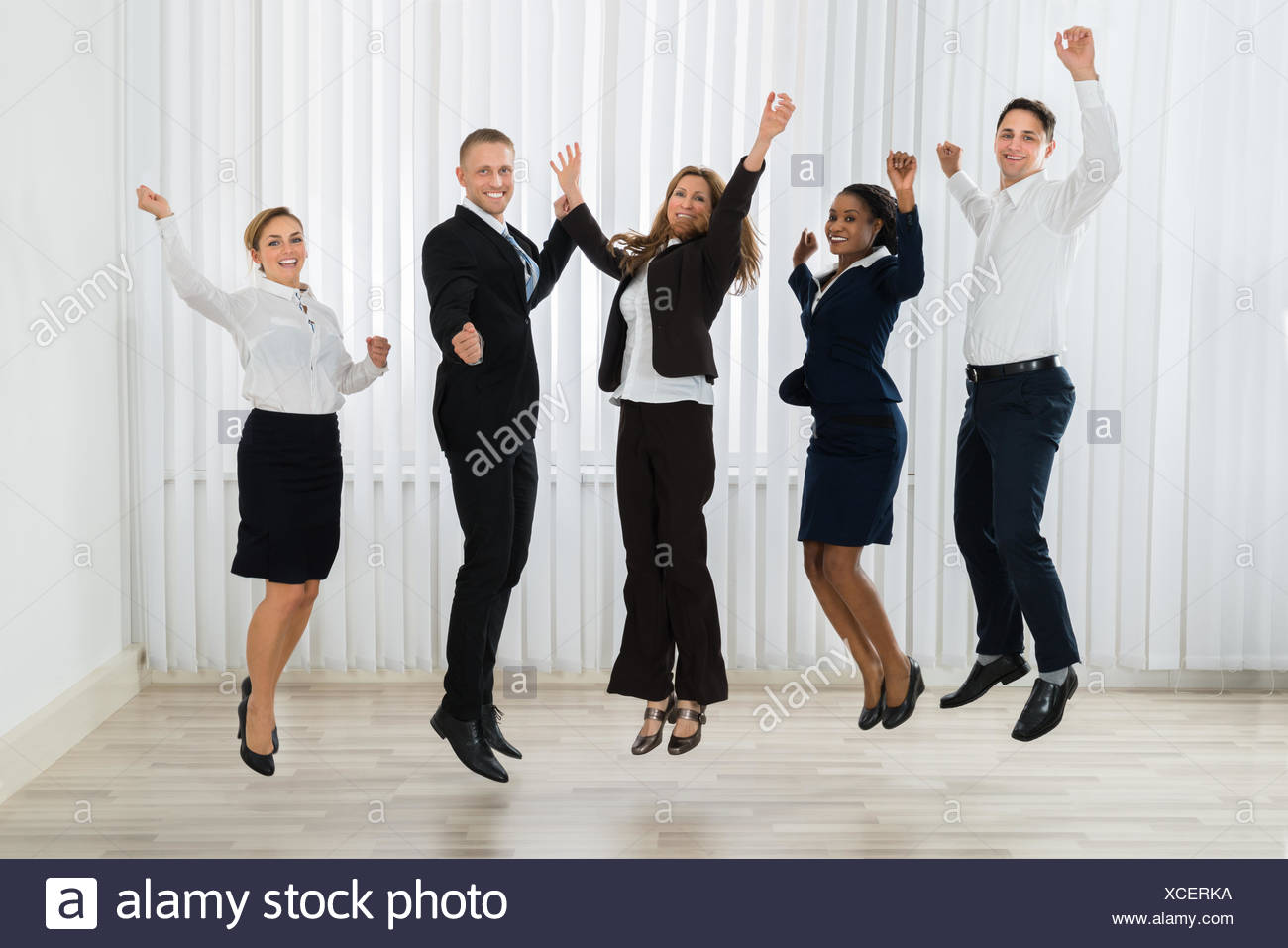 Businesspeople Jumping In Joy - Stock Image