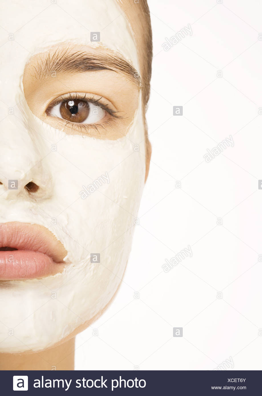 Woman with facial mask, extreme close-up - Stock Image