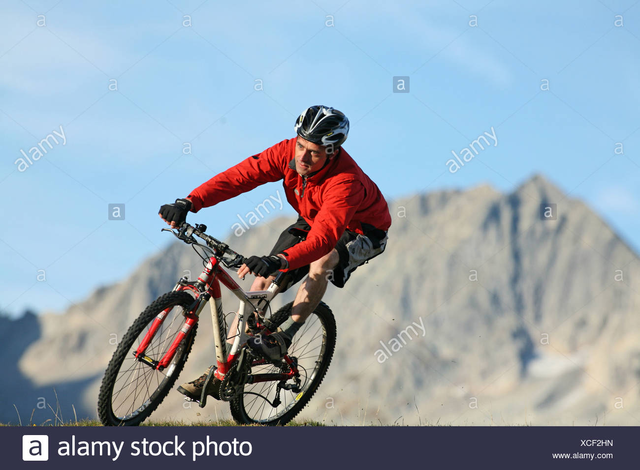 man singles action mountain biker biking biking bicycle bike biking bicycle riding a bike cyclist MTB mou - Stock Image