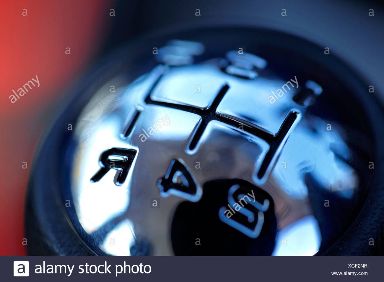 Close-up of a shift knob against blurred background - Stock Image