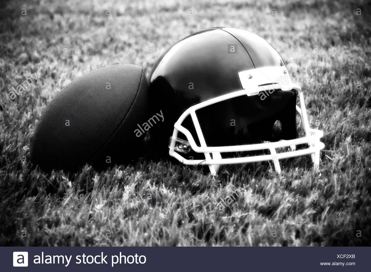 Football helmet and football - Stock Image