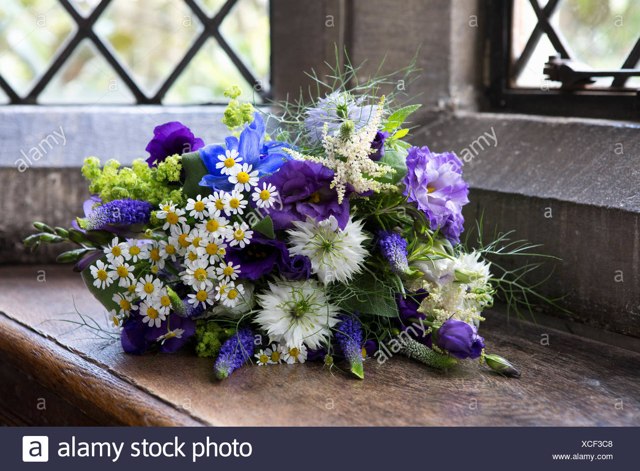 Close Up Of A Bouquet Of Blue And White Wedding Flowers Stock Photo