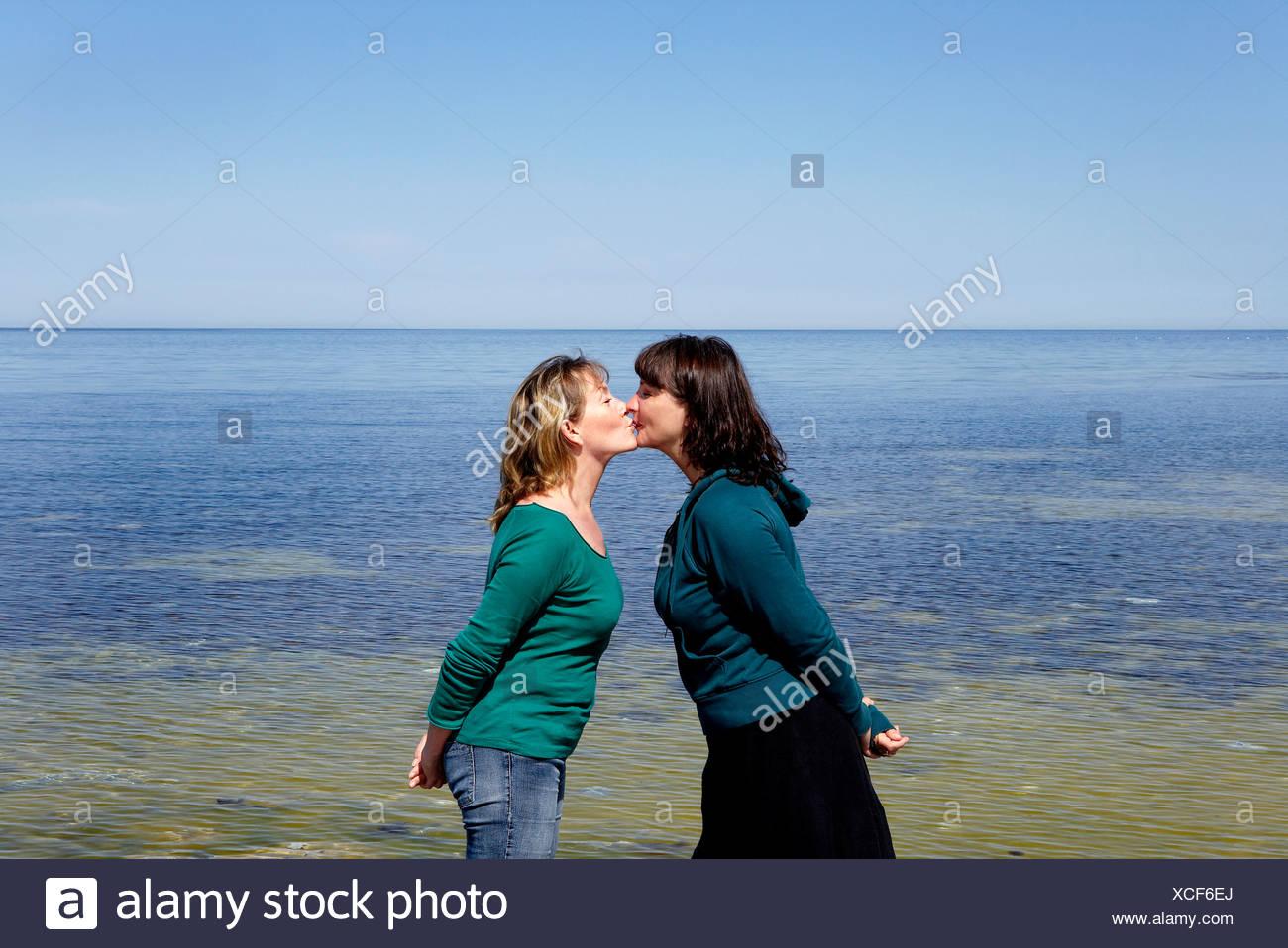 Two mature women kissing