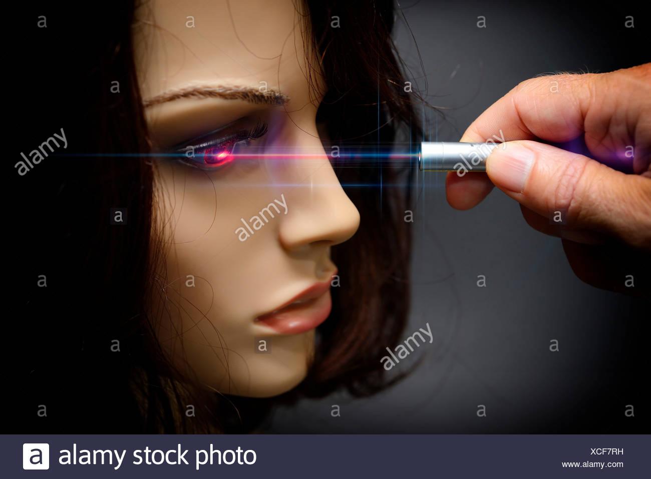 Laser pointer, mannequin, eye, dazzle, blind Stock Photo