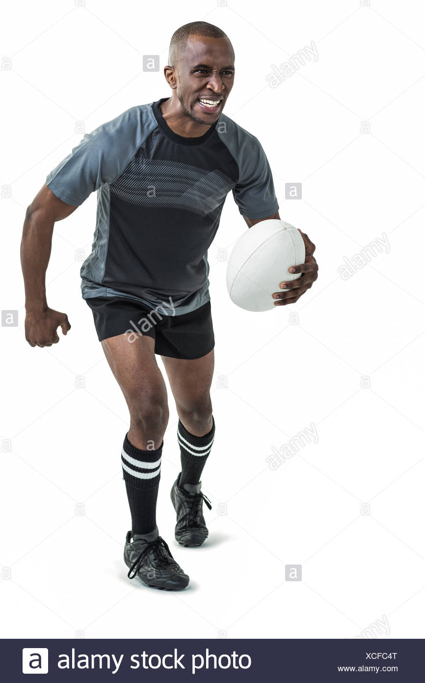 Sportsman running while playing rugby Stock Photo