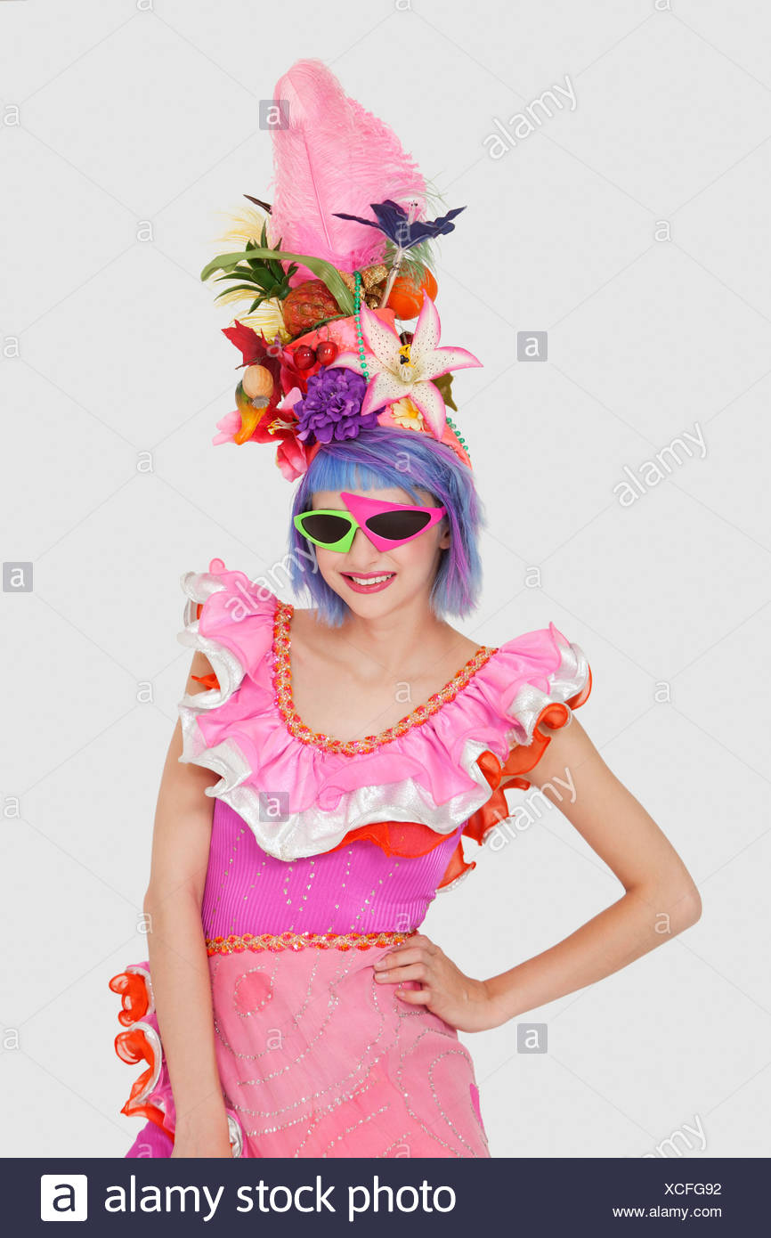 9c05097aa3f6 Portrait of beautiful young woman in Brazilian outfit and funky glasses over  gray background