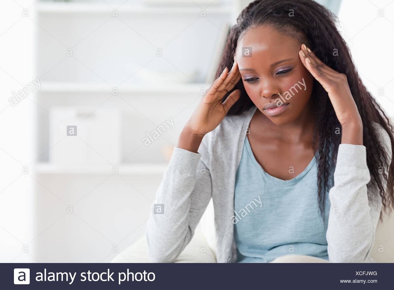 Woman experiencing a headache - Stock Image