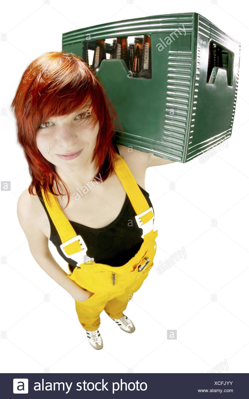 Redheaded girl carrying a box of beer - Stock Image