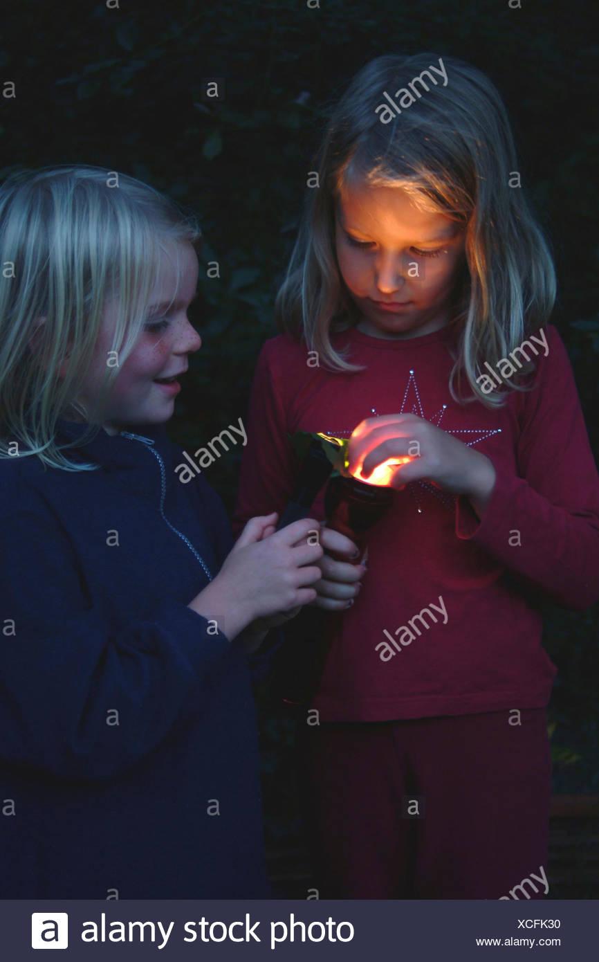 children with pocket light - Stock Image