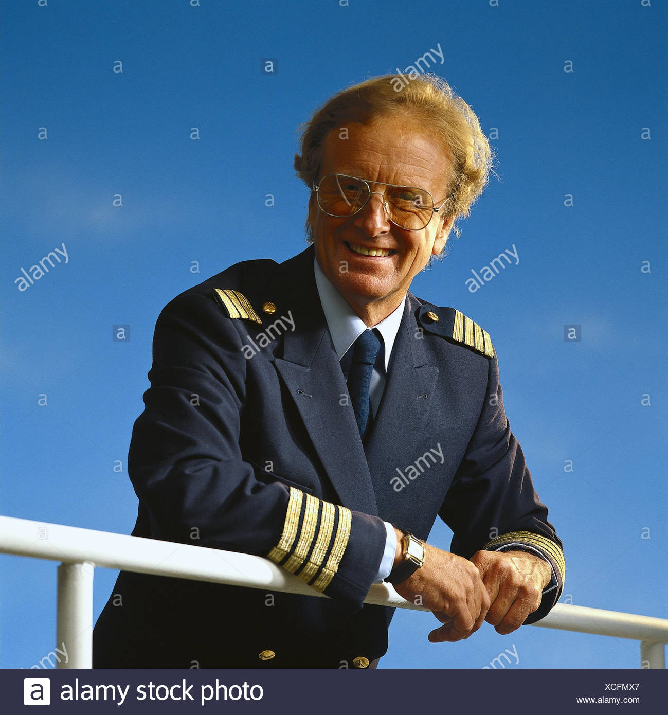 Ship, detail, rail, captain, outside, sea captain, navy, officer, naval officer, naval officer, occupation, navigation, man, uniform, glasses, smile, half portrait - Stock Image
