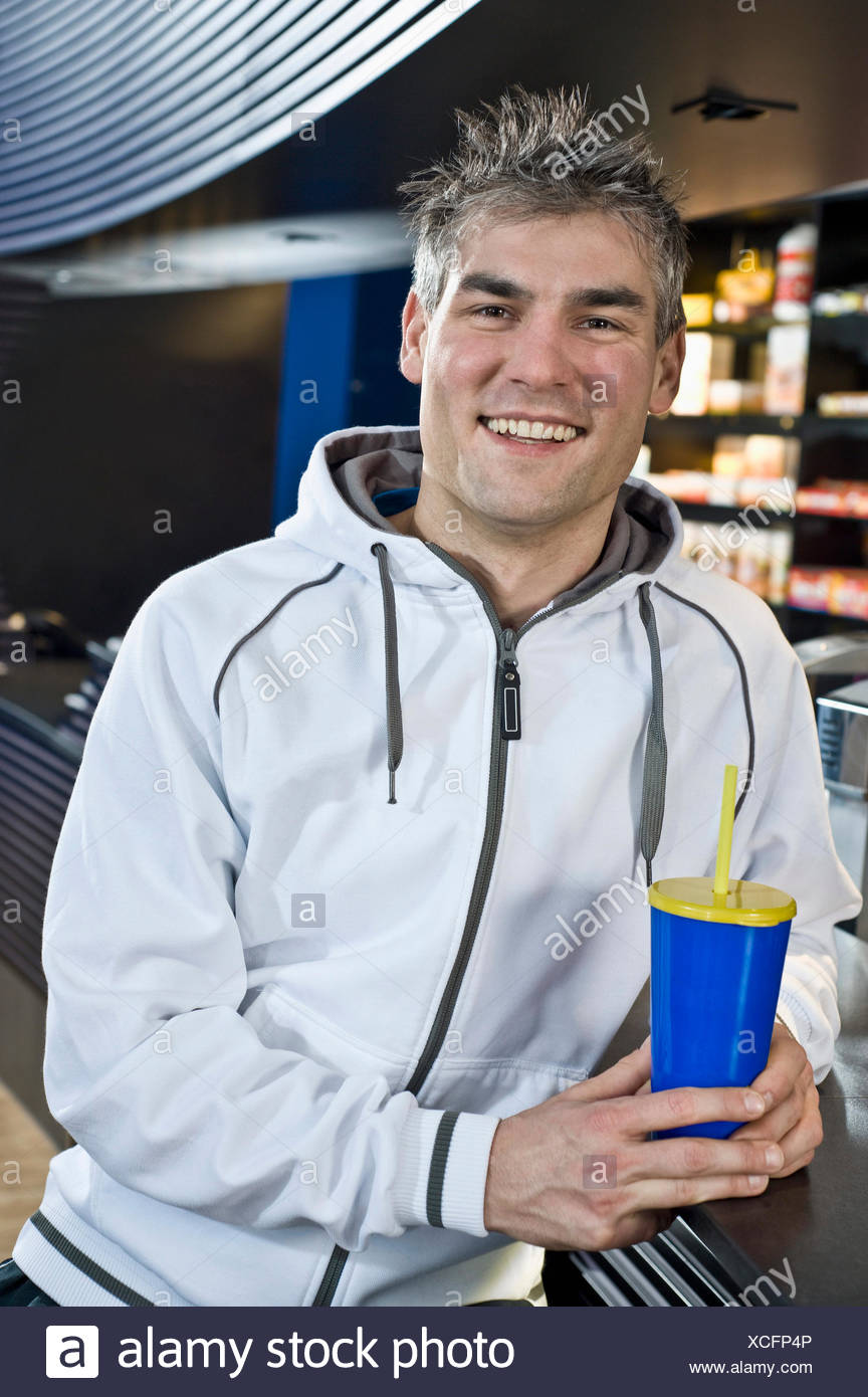 Smiling man at the bar of a gym - Stock Image