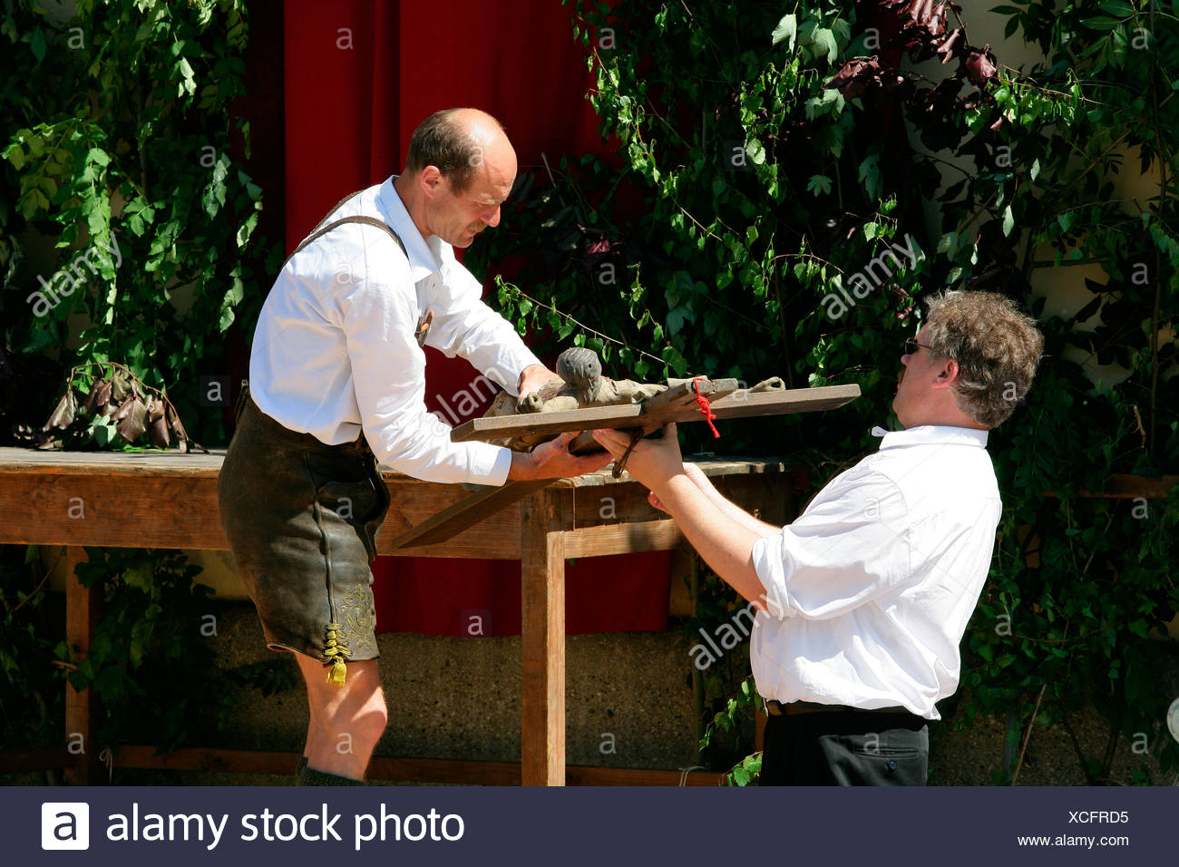 Altar being dismantled after the Corpus Christi procession in Muehldorf am Inn, Upper Bavaria, Germany, Europe - Stock Image
