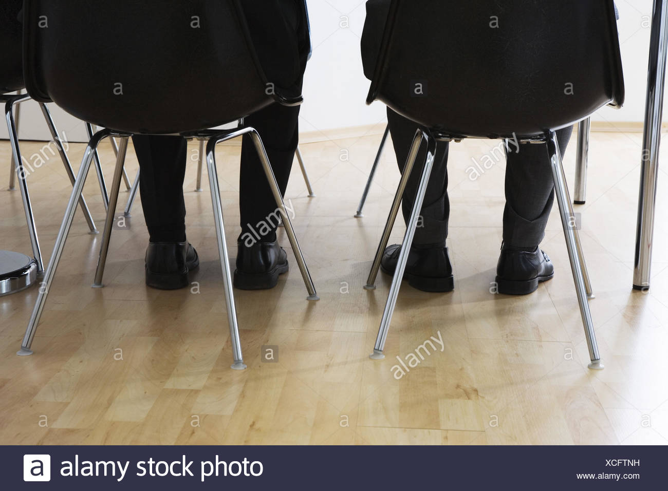 Men, detail, legs, chairs, sit,  Move opinion,   Participants business, office, attendant area, waiting rooms, application, applicants competitors two, - Stock Image