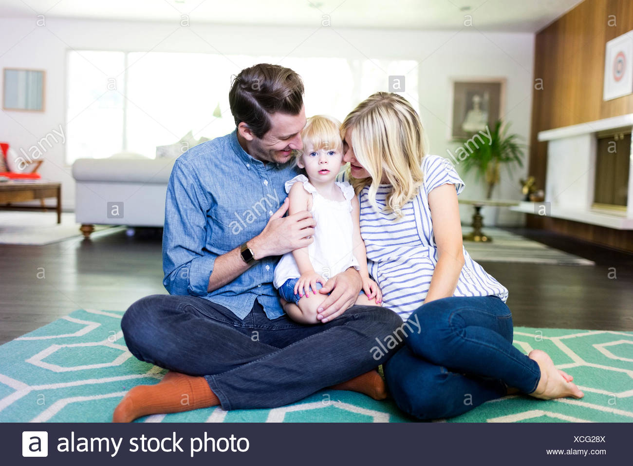 Family portrait with daughter (2-3) Stock Photo