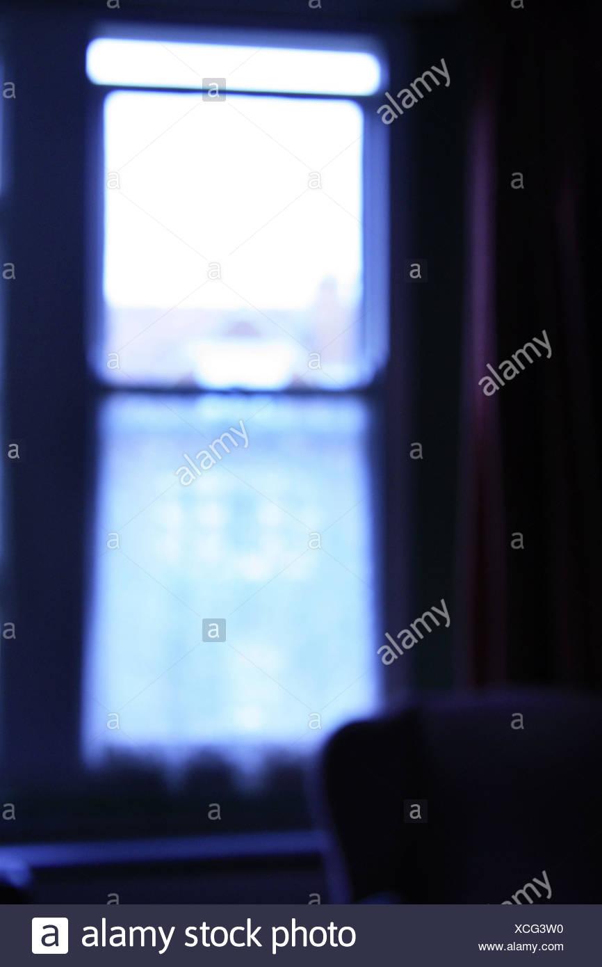 Sitting room, window, curtain, back light, blur, living space, room, room, armchair, living, inside, - Stock Image