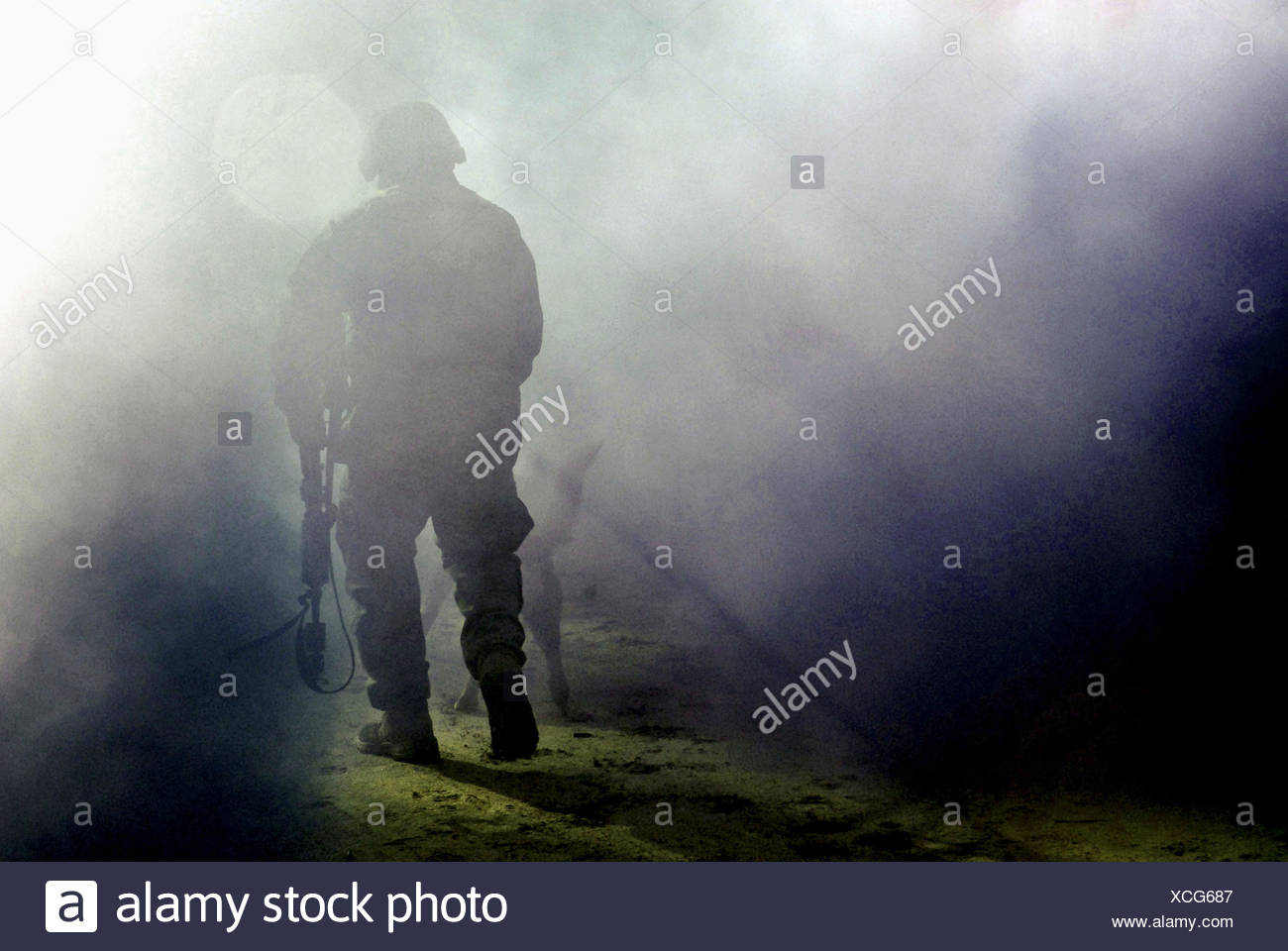 A student practices tactics for military operations in urban terrain training at Naval Air Engineering Station Lakehurst, N.J. - Stock Image