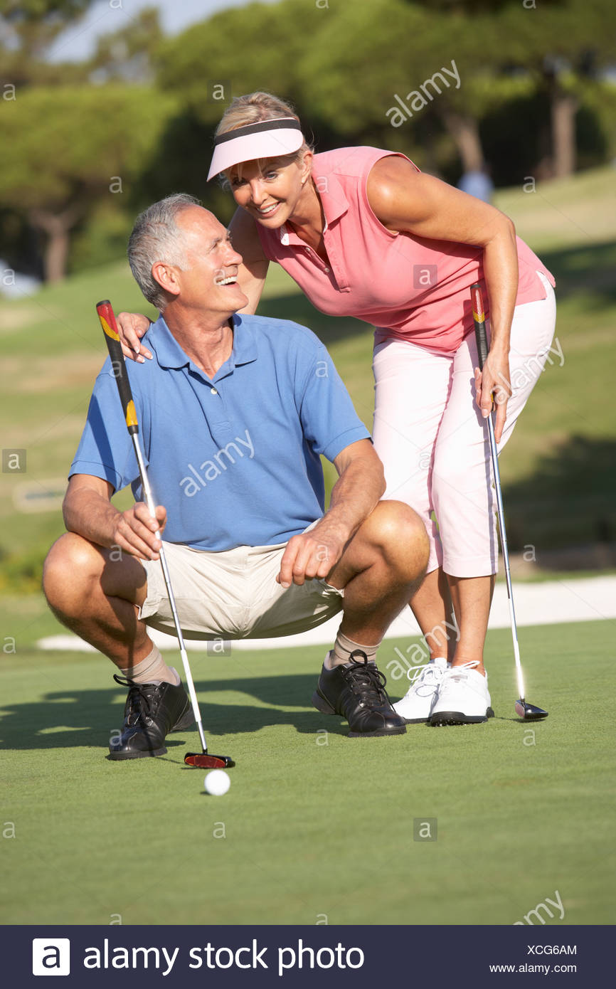 Senior Couple Golfing Golf Course Putting Green - Stock Image